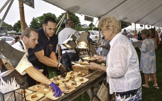It was a fine evening for some fabulous food when the 2018 Taste of Chatham came back to town on July 30, with area restaurants serving up delicious dishes to support Monomoy Community Services. Here, Daniel Cot é  and Ysmael Marte of Chatham Bars Inn serve up sumptuous sliders to a happy patron. Kat Szmit Photo  (photo: )