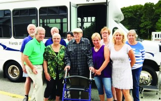 James Athens and several friends and members of the Friends of Council on Aging and council on aging took a tour around town on the new bus on Saturday. From left to right are Mike Mullane, COA Chairman Richard Waystack, Linda Johnson, Friends of COA President Jack Brown, Joanne Brown, James Athens, Cheryl Burnham, Chris Joyce, Molly Perdue and Andrea Terney. PHOTO COURTESY OF RICHARD WAYSTACK  (photo: Courtesy Richard Waystack)