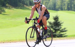 Even though he'd already swum for more than an hour and cycled more than 100 miles, Garrett Sherman was still smiling during the 41-kilometer run in the Ironman Mont-Tremblant, his first-ever full Ironman. Photo Courtesy of Garrett Sherman  (photo: )