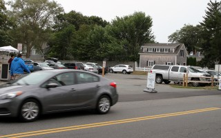 At times, the paid parking lot at the former Eldredge Garage site has only a handful of vehicles, but on drizzly days in August, the lot was filled nearly to capacity. ALAN POLLOCK PHOTO  (photo: Alan Pollock)