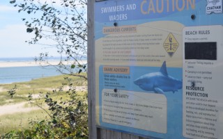 This sign at Chatham's Lighthouse Beach, like others at beaches along the Outer Cape, warns beachgoers and about the potential danger of swimming in waters where sharks are known to be. TIM WOOD PHOTO  (photo: Tim Wood)