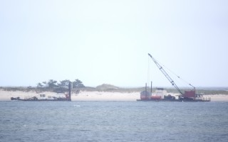 Barnstable County dredges sit in Chatham Harbor Thursday. TIM WOOD PHOTO  (photo: )