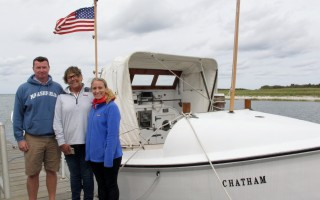 Matt Fitzgerald, grandson of the Pendleton's captain, poses with Bernie Webber's daughter Pattie Hamilton (center) and Webber's granddaughter, Leah. MARCIA BROMLEY PHOTO  (photo: Marcia Bromley)
