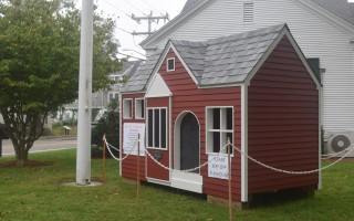 A playhouse replica of the Eldredge Public Library, constructed by Cape Associates, will be raffled to benefit the Friends of the Eldredge Public Library. The playhouse is on display on the lawn of the town offices, across the street from the historic library. TIM WOOD PHOTO  (photo: )