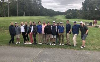 Members of Monomoy High School's boys and girls golf teams join their parents for a post-tournament photo op after finishing the All Sports Booster Club's second annual golf tourney. PHOTO COURTESY OF JOY JORDAN  (photo: )