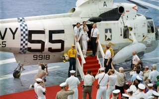 The Apollo 7 astronauts arrive on the deck of the USS Essex in the helicopter co-piloted by Chatham resident Don Broderick on Oct. 22, 1968. COURTESY PHOTO  (photo: )