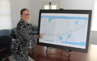 Chamber of Commerce Executive Director Cyndi Williams points to the boundary line of the proposed Harwich Port Cultural District. WILLIAM F. GALVIN PHOTO  (photo: William F. Galvin)