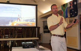 Jerome Rand, without his beard, tells his story of sailing into oblivion, a solo, non-stop, circumnavigation of the globe, at the Allen Harbor Yacht Club last Friday evening. WILLIAM F. GALVIN PHOTO  (photo: William F. Galvin)