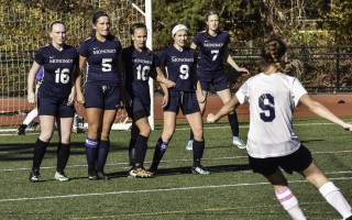Monomoy's Maggie Dever (16), Abby Higgins (5), Dakota Hesse (10), Abby Wallace (9), and Leah Nash (7) stand strong against a Rising Tide penalty kick near the end of their first round tournament game on Nov. 4. Kat Szmit Photo  (photo: )