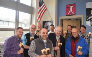 Monomoy Regional High School history teachers hold up their copies of the U.S. Constitution, 1,000 of which were donated to the school by Harwich residents Bob Doyle and Barry Worth. From left, Ian Hoffman-Terry, Matthew Brown, John Dixon, David Alexander, Kevin Bates, Doyle, John Anderson, Worth, and Rich Houston.  (photo: )