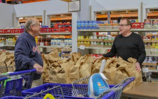 Leo Dunphy (left) and Rich Graveline of the Family Pantry are ready for the rush of clients during the Pantry's annual turkey distribution day Sunday.  Clients received a turkey with all the fixings for Thanksgiving dinner.  DEBRA DeCOSTA PHOTO  (photo: Debra DeCosta)