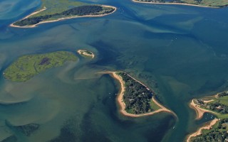 The purchase of Sipson's Island, center, under the auspices of the Friends of Pleasant Bay, will ensure preservation of 18 of the island's 24 acres as open space. SPENCER KENNARD PHOTO  (photo: )