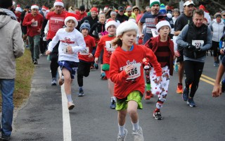 Runners of all ages take off at the start of the 2018 Santa Stampede in Orleans on Dec. 1. Barry Donahue Photo  (photo: )