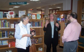 Lauren Stara (center), library building specialist with the Massachusetts Board of Library Commissioners, was greeted during a Dec. 10 tour of Snow Library by former director Mary Reuland (left). The tour was led by her successor, Tavi Prugno (right).  ED MARONEY PHOTO  (photo: Ed Maroney)