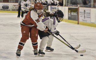 The Furies' Nikki Awalt (21) works to keep the puck away from Barnstable's Laura Cogswell (16) during game play Dec. 8 in Orleans. Kat Szmit Photo  (photo: )