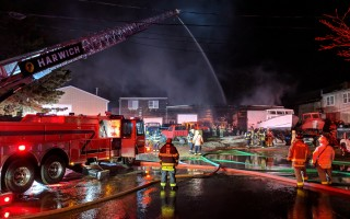 Crews from Chatham, Harwich, Brewster and Orleans extinguished a blaze in a commercial bay at Commerce Park North Thursday evening.  ALAN POLLOCK PHOTO  (photo: Alan Pollock)