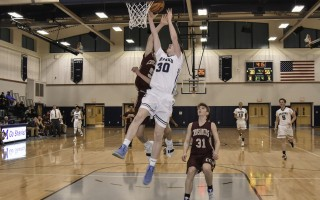 Monomoy's Aidan Melton (30) takes to the air for two points while under pressure from Cape Tech's Zach Higgins (5), as the Crusaders' Austin Walker (31) awaits a rebound opportunity. Kat Szmit Photo  (photo: )