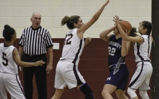Monomoy's Mackenzie Balfore (22) finds herself the recipient of Cape Tech's smothering second-half defense courtesy of Anais Catala (12) and Alexis Costa (1) during game play Jan. 17 at Cape Tech. Kat Szmit Photo  (photo: Kat Szmit)