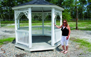 Cemetery Administrator Robbin Kelley displays the gazebo that was put in place for the pet burial ground on Queen Anne Road. CHRONICLE FILE PHOTO  (photo: William F. Galvin)