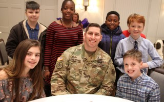 With Mass. National Guard Staff Sgt. Jeremy Armstrong of Harwich are (from left, back row) Aiden Hindle-White, Shanece James, Christiano Cheron, Cameron McCutcheon and (front row) Lilly Furman and Braden Burke.  ALAN POLLOCK PHOTO  (photo: Alan Pollock)