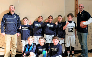 The Monomoy Travel Basketball program's grade four team celebrates after winning their championship game against Plymouth South on Feb. 9. Pictured are coach Jared Reeves, Aiden O'Keefe, Tony Johnson, Dezmond Wall, Cam Reeves, Jack Sheeran, coach Kevin Flynn, Tate Laramee, Hank Brown, and Ethan Carey.  CONTRIBUTED PHOTO  (photo: )
