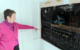 Harwich Historical Society Executive Director Janet Cassidy said she believes the students listed on the side of the chalkboard had the fun duty of ringing the school bell. ALAN POLLOCK PHOTO  (photo: Alan Pollock)