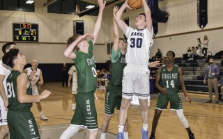 Monomoy's Aidan Melton (30) adds two points to his total of 20 against Sturgis West on Feb. 14, with Monomoy earning the win. Kat Szmit Photo  (photo: )