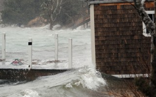 A storm surge batters a boathouse on Pleasant Bay in South Orleans during a coastal storm last March. FILE PHOTO  (photo: )