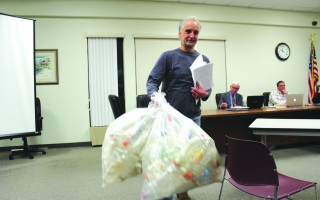 Patrick Otton has petitioned town meeting for a ban on the procurement and distribution of beverages in plastic bottles on town property. He demonstrated the need by displaying bags of plastic bottles collected from area beaches. WILLIAM F. GALVIN PHOTO  (photo: William F. Galvin)