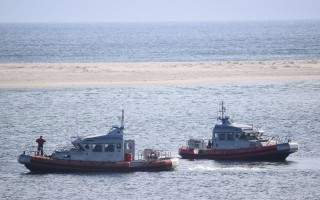 The Coast Guard conducts drills with its two 42-foot lifeboats off Lighthouse Beach this winter. The vessels are now stationed at the fish pier, and the agency is asking the town to consider creating slips at Old Mill Boatyard in Stage Harbor to accommodate them. FILE PHOTO  