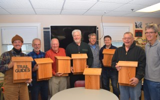 Members of the Chatham-Harwich Newcomers Club woodworking group with the trail boxes they made for the Chatham Conservation Department. From left, Assistant Conservation Agent Paul Wightman, Jonas Robinson, Warren Chane, Chris Seymour, Steve Patzman, Wayne Glifort, Charlie Curtiss and Rich Simpson. TIM WOOD PHOTO  (photo: )