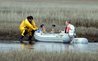 Harwich firefighters recover a mannequin from the Herring River marsh Monday afternoon. ALAN POLLOCK PHOTO  (photo: Alan Pollock)