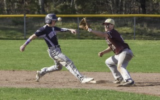 Monomoy's Hunter Brackett (9) hops back to second just ahead of the throw to Cape Tech second baseman Jack Derosier (10) during game play at Cape Tech on April 25. Kat Szmit Photo  (photo: Kat Szmit)