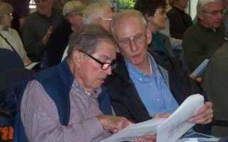 Barry Lupton, left, and Bob Renn review facts and figures at the Orleans Citizens Forum on town meeting warrant articles April 25 at the senior center. Ed Maroney Photo  (photo: )