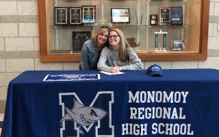 Monomoy's Aoife Daly shares a special moment with mom Denise after signing her letter of intent to play field hockey for Colby-Sawyer College in New Hampshire this fall. KAREN GUILLEMETTE PHOTO 
