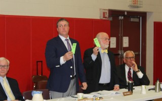 Selectmen Michael MacAskill and Donald Howell stand to cast their votes against the town's $39.6 million operating budget in Monday night's town meeting. WILLIAM F. GALVIN PHOTOS  (photo: )