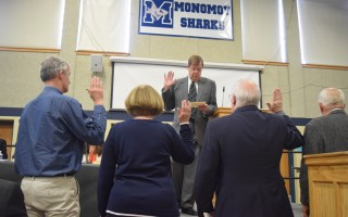 Moderator William Litchfield swears in tellers at Monday's opening night of the annual town meeting. TIM WOOD PHOTO  (photo: )
