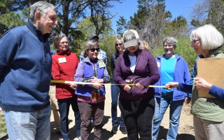 Selectman Shareen Davis cuts the ribbon at the new accessible trail at the Rolf E. Sylvan Gardens Conservation Area Saturday, while fellow Selectman Peter Cocolis (left) and Friends of Sylvan Gardens President Carol Odell (right) and other Friends members and supporters look on. TIM WOOD PHOTOS  (photo: )