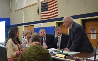 Selectmen confer prior to the annual town meeting. Tim Wood PHOTO   (photo: )