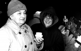 Juliet Bernstein leads a vigil outside the Eldredge Public Library in 1995, after selectmen voted against granting her permission to do so. FILE PHOTO  (photo: Tim Wood)