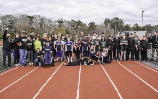 The Monomoy Unified Track Team, which includes Matthew Neal, William Ramos, Joseph Gallante, Hannah Mitchell, Grace Jodice, Brendan Pawlina, Patrick Sullivan, and Rory Farris, joins forces with members of the Nauset and Riverview Unified Track teams after their May 15 meet. Kat Szmit Photo  (photo: Kat Szmit)