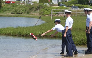 A member of Coast Guard Station Chatham puts a floral wreath in the Oyster Pond as a Memorial Day tribute to those lost at sea.  ALAN POLLOCK PHOTOS  (photo: Alan Pollock)