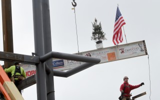 The topping-off beam holds the signatures of students, supporters and workers, and carries an American flag and a pine tree, which hearkens to the first topping-off ceremonies held by Scandinavian carpenters.  ALAN POLLOCK PHOTO  (photo: Alan Pollock)
