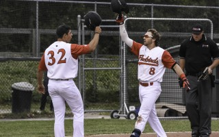 The Firebirds' Josh Zamora (8) high-fives teammate Max Troiani (32) after both came home on a two-run homer hit by Zamora that gave Orleans a win in its home and season opener on June 10. Kat Szmit Photo  (photo: Kat Szmit)