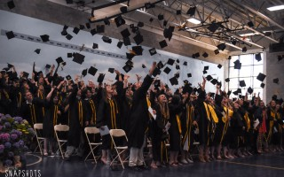 The Nauset Regional High School Class of 2019 celebrates graduating with the traditional cap toss at the end of commencement on June 8.  (photo: )