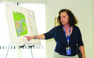 West Harwich resident Mary Albis points to side streets around the proposed Harwich Retail development that will become more congested as traffic seeks alternative routes. WILLIAM F. GALVIN PHOTO  (photo: )