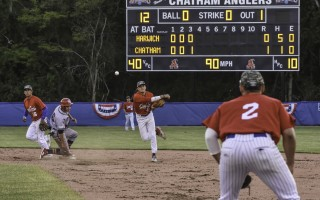Chatham shortstop Ben Ramirez (49) makes a throw to first baseman Jamal O'Guinn II for a double play beneath the glow of the new Veteran's Field scoreboard on June 14. Kat Szmit Photo  (photo: Kat Szmit)