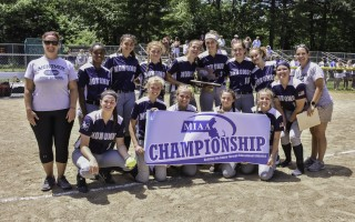 The Monomoy girls varsity softball team shows off its new addition to the trophy case after the D3 South finals on June 15. Kat Szmit Photo  (photo: )