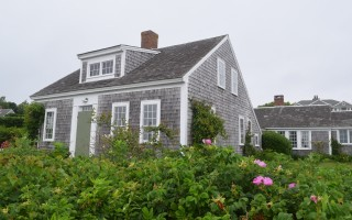 Starboard Light, the historic home overlooking Stage Harbor, will not be demolished, the owner said this week. But permission is being sought to remove additions to the rear that the owner said are not historic. FILE PHOTO 
