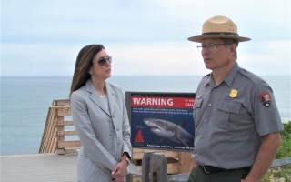Chatham Town Manager Jill Goldsmith and Cape Cod National Seashore Supt. Brian Carlstrom conferred before a press conference at Marconi Beach in Wellfleet July 2.  ED MARONEY PHOTO  (photo: Ed Maroney)